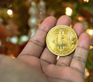 bitcoin munt in de hand